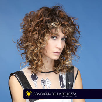 Pettinature per capelli ricci media lunghezza